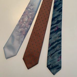 Three mens ties in multi colors and patterns